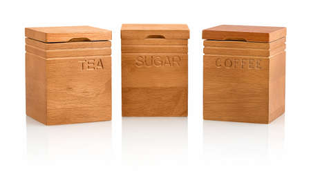 Kitchen craft natural elements acacia wood tea, coffee & sugar storage containers isolated on white background with shadow reflection. Wooden tea, sugar & coffee canister on white backdrop. 版權商用圖片