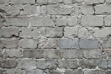 Old broken gray brick wall background. Old gray damaged brick wall texture, Gray brick backdrop and texture for text or image. Gray background for design, design and template.