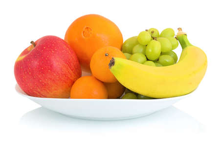 Bowl of fresh fruits isolated on white background with shadow reflection. Apple orange mandarin grape and banana in white bowl. 版權商用圖片