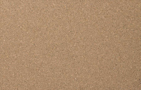 Cork board wood surface. Cork board background. Cork table. Close up background and texture of cork board wood surface. Nature product industrial. 版權商用圖片