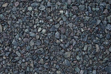 Close up grey granite gravel background. Pebble background Gravel texture. Gravel background. Stones texture.