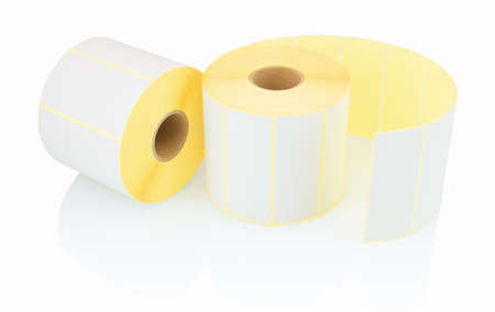 White label rolls isolated on white background with shadow reflection. White reels of labels for printers. Labels for direct thermal or thermal transfer printing. White stickers on white backdrop. 版權商用圖片