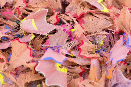 Color pencil shaves background. Colorful pencil shavings in close-up.