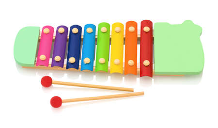 Rainbow colored wooden toy xylophone isolated on white background with shadow reflection. Colorful wooden metallophone toy isolated on a white background. Xylophone with sticks. Music instrument.