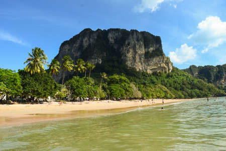 easygoing: Ao Nang is considered being among the most beautiful beaches in Thailand. It is quite understandable when observing the fresh and green environment and clear water that surrounds the easy-going environment, by some even called paradise. Stock Photo
