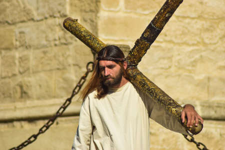 for: A close up picture of a street performer who is trying to illustrate Jesus Christs famous suffering.