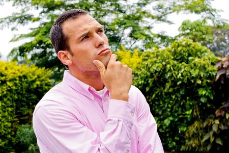 collared shirt: Young adult male thinking with collared shirt