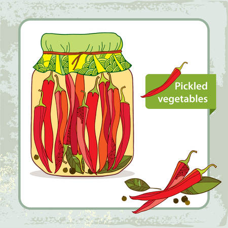pickled: Pickled red chili peppers in the glass jar with bay leaf and black pepper