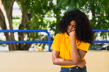 Young black woman 20-25 years old with curly hair in annoyance or dissatisfaction 免版税图像