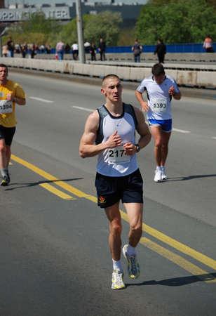 BELGRADE, SERBIA - APRIL 22: Undefined man runs on April 22, 2012 in Belgrade marathon  Stock Photo - 13267108