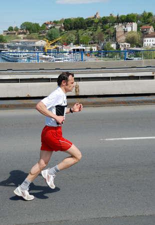 BELGRADE, SERBIA - APRIL 22: An unidentified man runs in 25th Belgrade Marathon on April 22, 2012 in Belgrade, Serbia  Stock Photo - 13365049