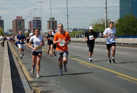 BELGRADE, SERBIA - APRIL 22: A group of marathon competitors during the 25th Belgrade Marathon on April 22, 2012 in Belgrade, Serbia  Stock Photo - 13365051