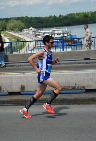 BELGRADE, SERBIA - APRIL 22: An unidentified man runs in 25th Belgrade Marathon on April 22, 2012 in Belgrade, Serbia  Stock Photo - 13365050