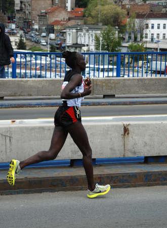 BELGRADE, SERBIA - APRIL 22: Mary Ptikany runs on April 22, 2012 in Belgrade marathon. Mary Ptikany won the women's race in 2:42:47  Stock Photo - 13365089