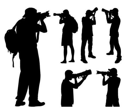 telephoto: photographers with telephoto lens silhouettes