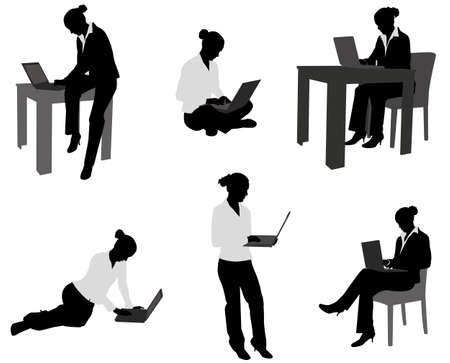 woman working on her laptop silhouettes