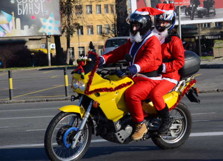 serbia xmas: BELGRADE, SERBIA - DECEMBER 27:  Undefined Santa delivering humanitarian aid in form of gifts to   disabled children during annual Santa Claus Motorcycle Parade on 27 December 2014 in Belgrade, Serbia Editorial