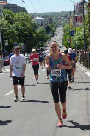 belgrade: BELGRADE, SERBIA - APRIL 16: An unidentified woman runs in 29th Belgrade Marathon on April 16, 2016 in Belgrade, Serbia