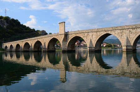 mehmed: The Mehmed Pasa Sokolovic Bridge(XVI century) historic bridge  over Drina river in Visegrad,Bosnia and Herzegovina