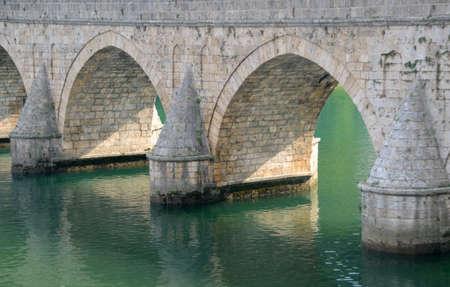 visegrad: The Mehmed Pasha Sokolovic Bridge(XVI century) historic bridge  over Drina river in Visegrad,Bosnia and Herzegovina