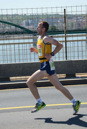 BELGRADE, SERBIA - APRIL 21: An unidentified man runs in 31st Belgrade Marathon on April 21, 2018 in Belgrade, Serbia
