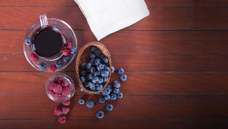 Summer berries, raspberries and blueberries on wooden background table photo