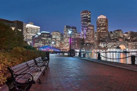boston tea party: Boston Harbor and Financial District at night in Boston, Massachusetts. Stock Photo