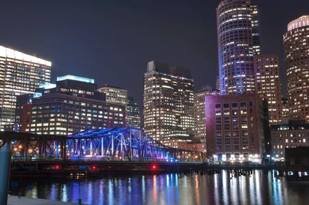 boston tea party: Boston Harbor and Financial District at night in Boston, Massachusetts. Stock Photo