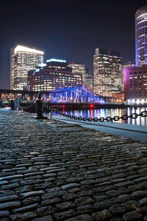 Boston Harbor and Financial District at night in Boston, Massachusetts. photo