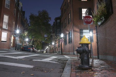 boston tea party: Narrow street in Beacon Hill at night, Boston. Stock Photo