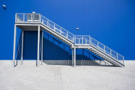 fire escape: Galvanized Industrial Stairs Fire Escape Blue Panels Wall Stock Photo