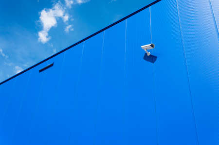 cctv camera: CCTV camera. Security camera on the blue wall. Private property protection. Stock Photo