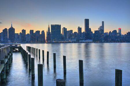 nations: United nations building on Manhattan New York City Skyline Sunset Stock Photo