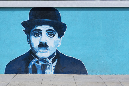 chaplin: VENICE BEACH CALIFORNIA, USA MAY 29: Charlie Chaplin mural on the wall at Venice Beach in Losa Angeles on May 29, 2015. Charlie Chaplin, KBE 16 04 1889 25 12 1977 was an English comic actor and filmmaker who rose to fame in the silent film era. Editorial