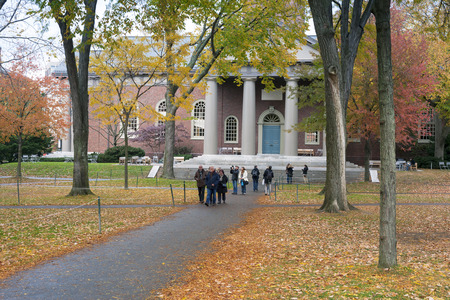 harvard: CAMBRIDGE, MA, USA - OCTOBER 10, 2013: Students at Harvard Yard, old heart of Harvard University campus, on a beautiful Fall day in Cambridge, MA, USA on October 10, 2013.