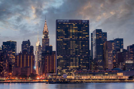 united nations: New York City, Manhattan famous landmark buildings skyline at beautiful colorful sunset, United Nations Headquarters