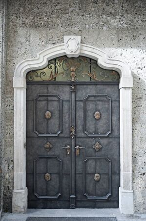 faraway: Old historical decorative building metal door, mysterious concept Stock Photo