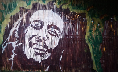 NOVI SAD, SERBIA - JUNE 10, 2016: Graffiti portrait of Bob Marley, a famous Jamaican reggae singer-songwriter and guitarist on the wall, June 10 2016, in Novi Sad Serbia