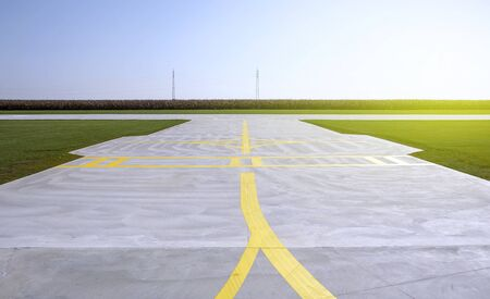 Yellow lines on a runway of small sport airport