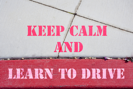 Keep Calm and learnd to drive sign on parking lot