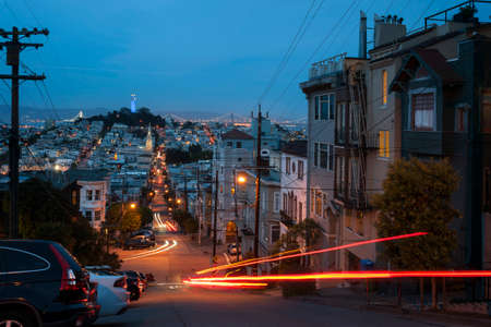 iluminated: Streets of San Francisco at dusk with iluminated Coit Tower in the distance