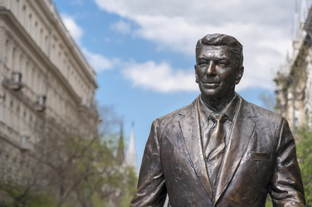 BUDAPEST, HUNGARY - APRIL 19, 2015: Statue of the former U.S. President Ronald Reagan on the background of Hungarian Parliament Building. Statue by sculptor Istvan Mate was unveiled on June 29, 2011.