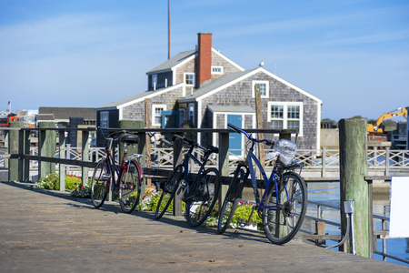 Tourist Bikes in Nantucket Harbour in the sunny morning Stock Photo