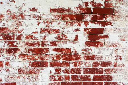 Abstract background Old damaged peeled brick wall painted red