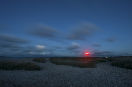 Brant Point Lighthouse at Night, famous tourist attraction and Landmark of Nantucket Island Stock Photo