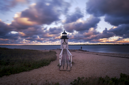 Sunset at Brant Point Lighthouse, famous tourist attraction and Landmark of Nantucket Island