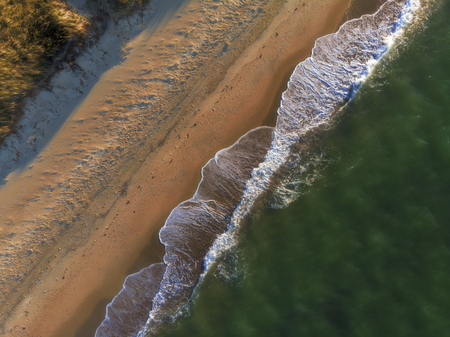 Abstract Textures Aerial View of Sandy Beach and Waves in Sunset from Above