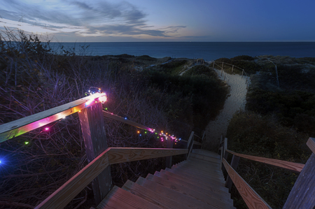 Steps beach at night lighten up with Christmas lights, famous tourist attraction and Landmark of Nantucket Island Stok Fotoğraf