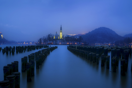 Compositing Shot of New York City Pier Poles and Winter time Bled Lake in Slovenia