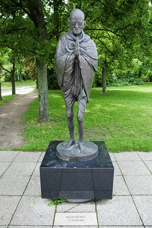 BUDAPEST - CIRCA June 2013: Mahatma Ghandi Monument in Garden of Philosophy, on Gellért Hill, by sculptor Nandor Wagner, consists of eight bronze statues. The composition shows the development of human kind and aims for a better mutual understanding.